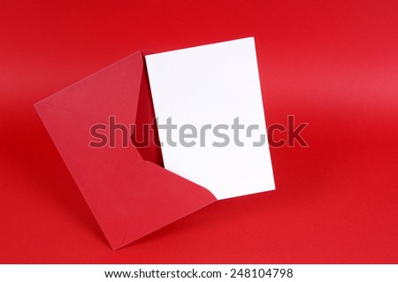 Blank white valentine card or love letter with red envelope and background.  Space for copy.