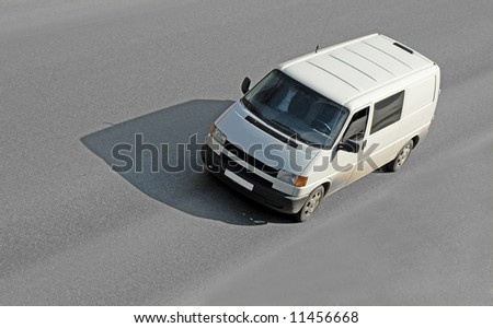 "blank white van on road  - See similar images of this ""Business vehicles"" series in my portfolio - stock photo"