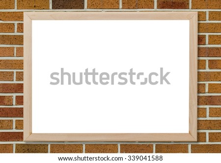 Blank whiteboard copyspace with wood frame on brickwall background. - stock photo