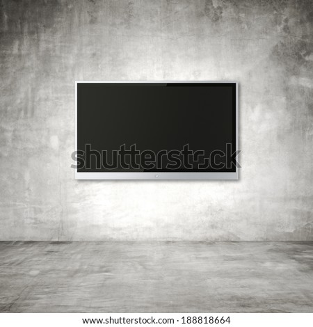 blank wide screen TV on wall in room - stock photo