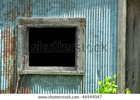 Blank window of an old garage. Window area has clipping path. - stock photo