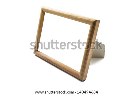 Blank wood photo frame isolated over white