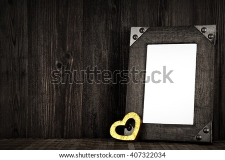 Blank wooden frame with golden heart - love mockup - stock photo