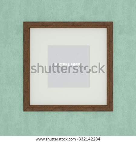 Blank wooden picture frame on green wall - stock photo