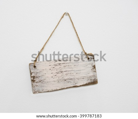 blank wooden sign hanging on the wall