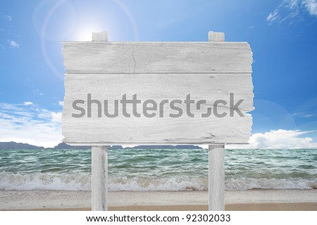blank  wooden  sign on beach