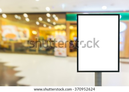 Blank wooden sign with copy space for your text message or content in modern shopping mall. - stock photo