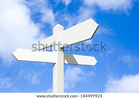 Blank wooden signpost with four arrows over blue sky - just add your text. - stock photo