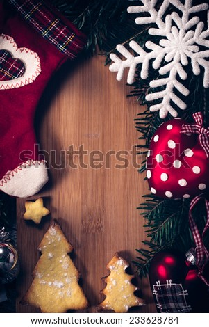 Blank wooden space in the middle of Christmas decoration - stock photo