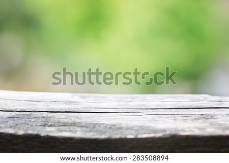Blank wooden table for picnic in the open summer air - stock photo