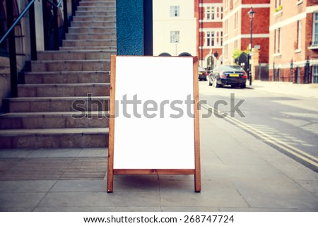 blank wooden whiteboard restaurants advertising street sign with - stock photo