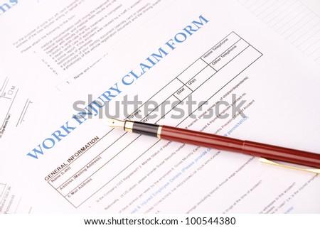 Blank work insurance claim form and fountain pen - stock photo