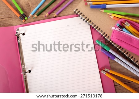 Blank writing book, student desk, pencil, top view  - stock photo