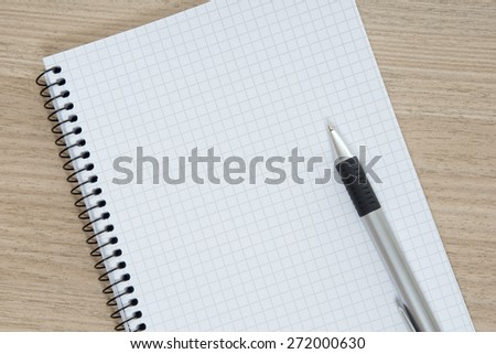 Blank writing pad with a pen / writing pad - stock photo