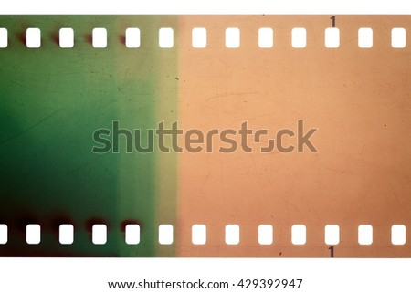 Blank yellow and green vibrant noisy film strip texture background