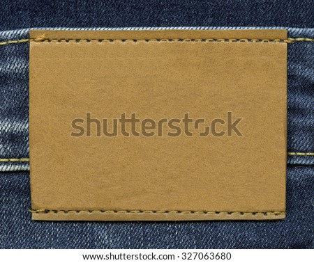 blank yellow leather label on jeans background