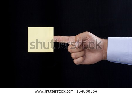Blank Yellow Note On the Index Finger - stock photo