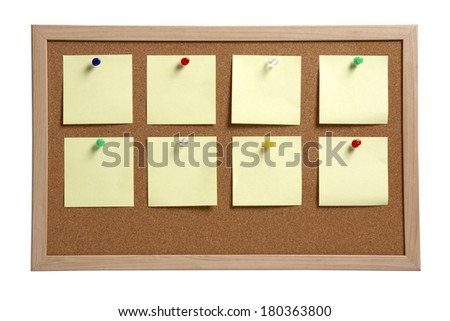 blank yellow notes pinned to cork board on white background - stock photo