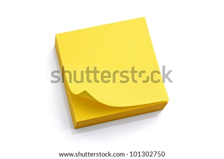 Blank yellow sticky note block isolated on white background - stock photo