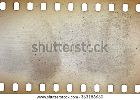 Blank yellow vibrant noisy film strip texture background - stock photo
