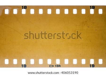 Blank yellow vibrant noisy filmstrip isolated on white background - stock photo