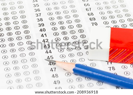 Blanked answer sheet with eraser - stock photo