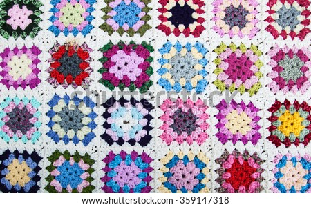 blanket made of granny squares - home craft - stock photo