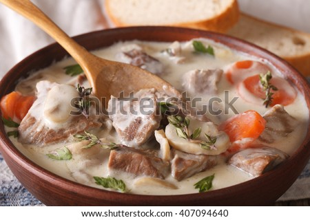 Blanquette of veal in a creamy sauce in a bowl on the table. horizontal - stock photo