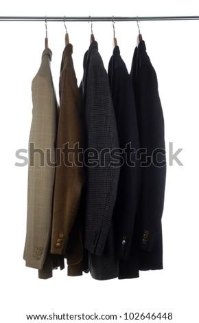 Blazers and Jackets on hangers - stock photo