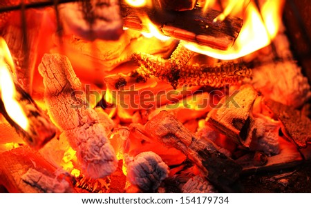 Blazing fire in Grilled. Close up. Whole background. - stock photo