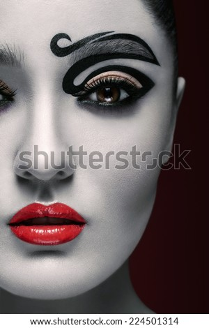 bleached face with makeup (red background) - stock photo