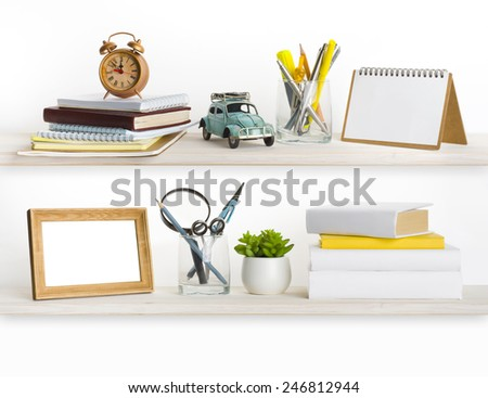 Bleached wooden shelves with different home related objects - stock photo