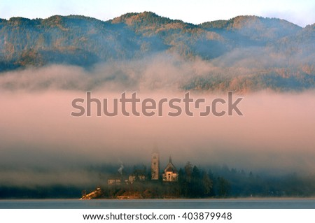 BLED - DECEMBER 20 : Church of the Assumption at 20 December, 2015 in Bled, Slovenia. Bled with its lake,churches and castle is the most popular tourist attraction of Slovenia. - stock photo