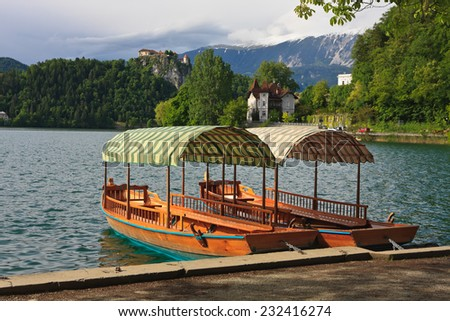 Bled  island with the castle and mountains in background , Slovenia - stock photo