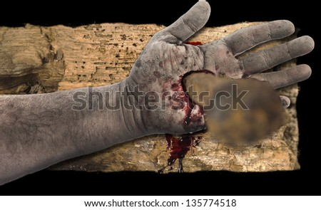 Bleeding hand with nail in it on wood - stock photo