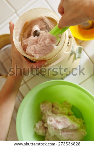 Blend all the ingredient and fish meat using blender - stock photo