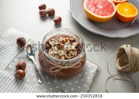 Blended buckwheat porridge with cocoa, hazelnuts and banana - stock photo