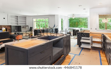 Blind corner cabinet, island drawers and counter cabinets installed - stock photo