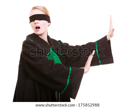 Blind justice. Woman lawyer attorney wearing classic polish (Poland) black green gown covering eyes with blindfold isolated on white - stock photo