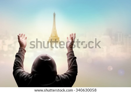 blind man pray over sky with light of hope over middle of Paris city France in pray for Paris concept - stock photo