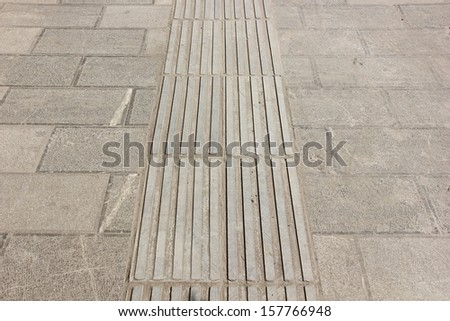 Blind people's track. - stock photo