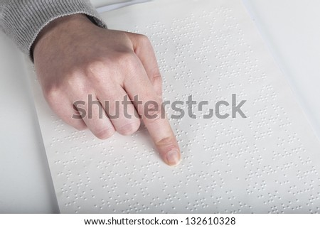 Blind reading text in braille language - stock photo
