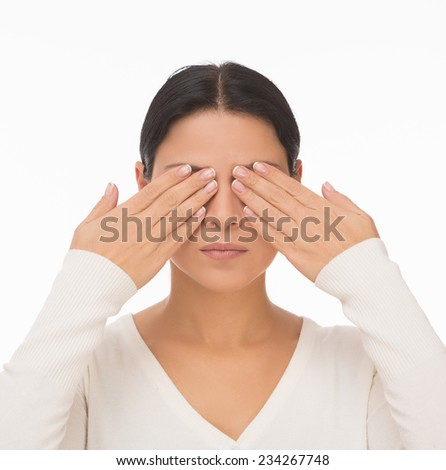 Blind woman closed face with hands isolated on white - stock photo