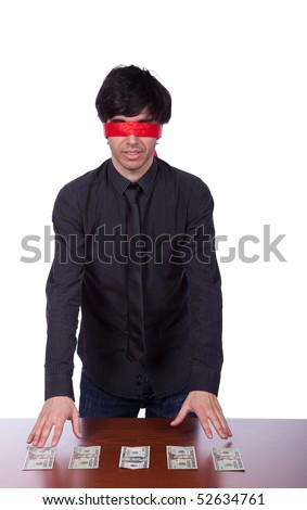 blindfold businessman trying to find his money (isolated on white) - stock photo