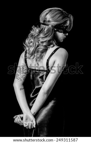 Blindfold woman with hands behind her back black and white