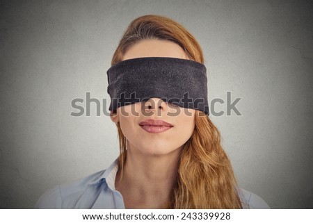 Blindfolded red haired woman - stock photo