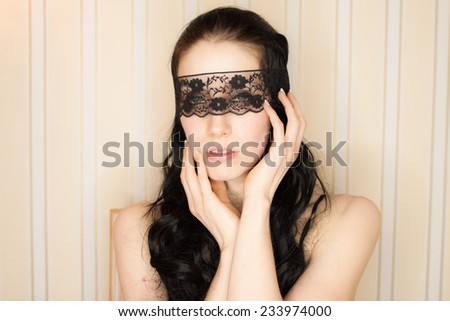 blindfolded sexy woman - stock photo