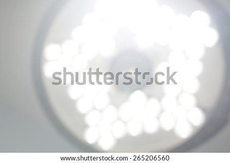 Blinding operating room light just after waking up from anesthesia.                     - stock photo