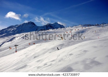 Blinding snow at a ski resort in the Alps mountains