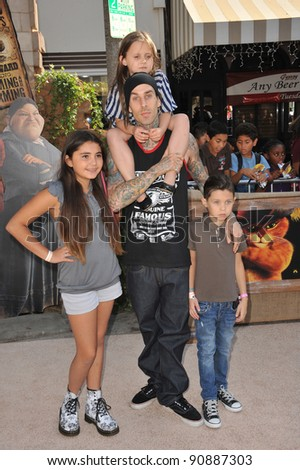 "Blink 182 star Travis Barker & kids at the Los Angeles premiere of ""Puss in Boots"" at the Regency Village Theatre, Westwood. October 23, 2011  Los Angeles, CA Picture: Paul Smith / Featureflash"